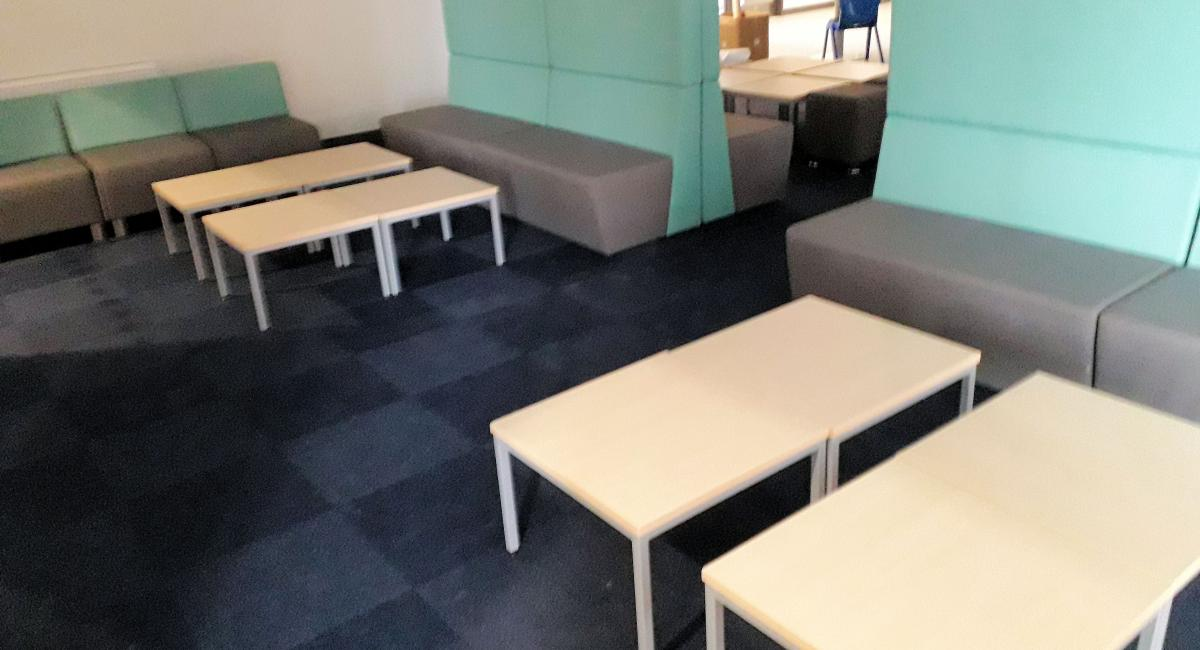 Breakout bench seating with high backs, finished in two tone fabrics.