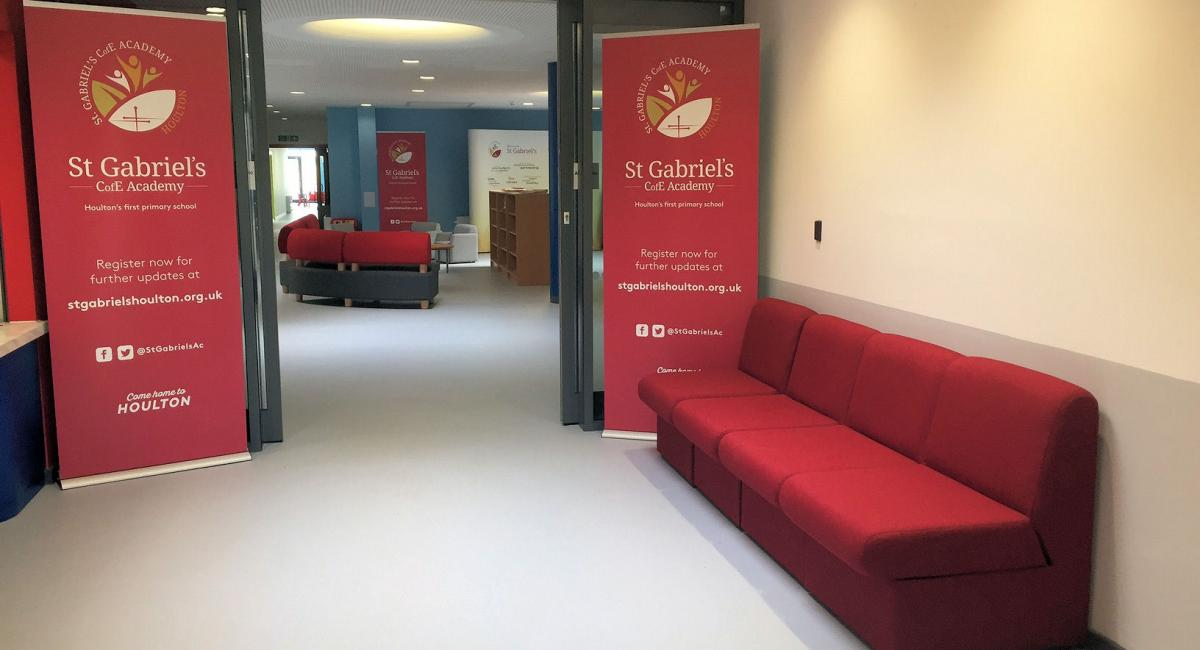 School welcome area, with red soft bench seating area