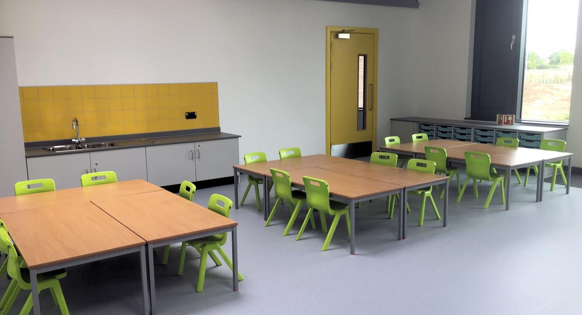 Classroom fully welded tables and one piece Postura+ classroom chairs finished in lime green.